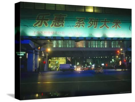Illuminated Signs Brighten a Shanghai Street at Night--Stretched Canvas Print