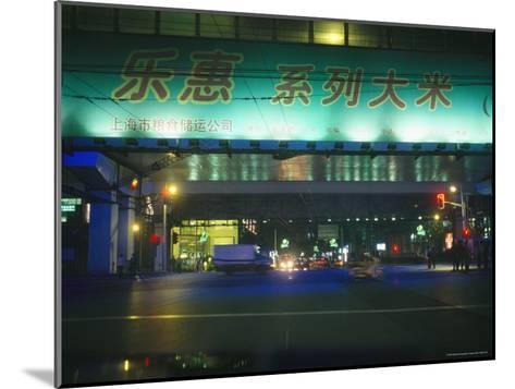 Illuminated Signs Brighten a Shanghai Street at Night--Mounted Photographic Print