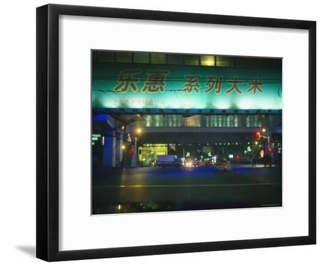 Illuminated Signs Brighten a Shanghai Street at Night--Framed Art Print