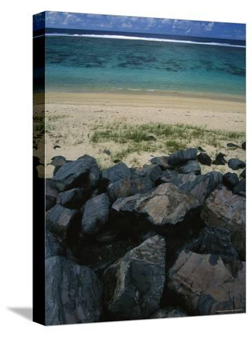 Calm Surf Breaking on Sandy Shore with Dark Stones in Foreground-Todd Gipstein-Stretched Canvas Print