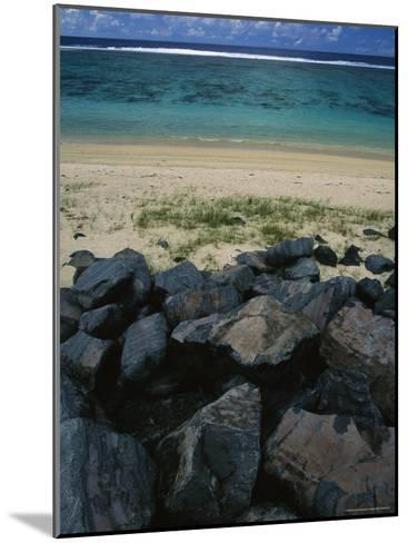 Calm Surf Breaking on Sandy Shore with Dark Stones in Foreground-Todd Gipstein-Mounted Photographic Print