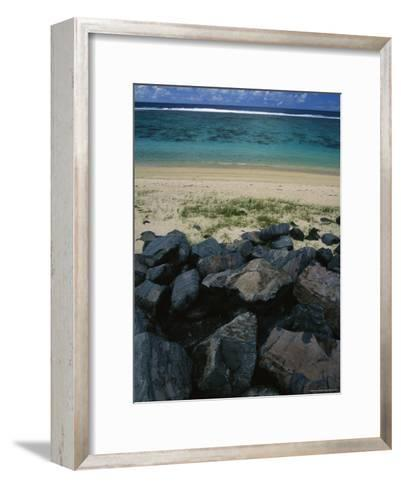 Calm Surf Breaking on Sandy Shore with Dark Stones in Foreground-Todd Gipstein-Framed Art Print