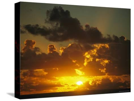 Sunset Through Dramatic Clouds over the Vast Pacific Ocean-Todd Gipstein-Stretched Canvas Print