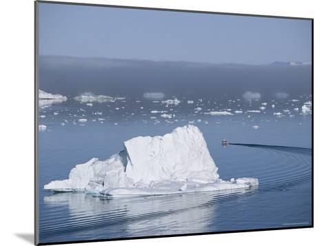 Fishing Boat Maneuvers Around Icebergs near the Ilulissat Glacier-Sisse Brimberg-Mounted Photographic Print