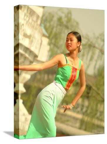 A Dancer Performs at the Chinese Ethnic Culture Park-Richard Nowitz-Stretched Canvas Print