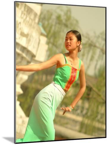 A Dancer Performs at the Chinese Ethnic Culture Park-Richard Nowitz-Mounted Photographic Print
