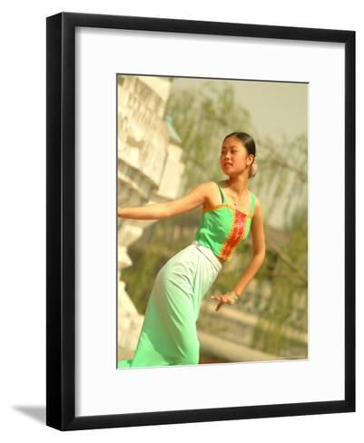 A Dancer Performs at the Chinese Ethnic Culture Park-Richard Nowitz-Framed Art Print