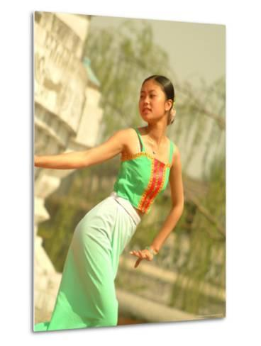 A Dancer Performs at the Chinese Ethnic Culture Park-Richard Nowitz-Metal Print