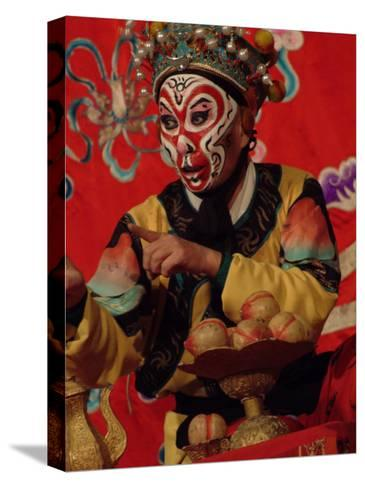 A Chinese Opera Performer in Monkey Makeup and Costume-Richard Nowitz-Stretched Canvas Print