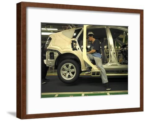 An Auto Worker Assembling a Hybrid Car at Plant in Japan--Framed Art Print
