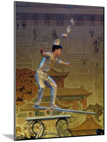 A Juggler Catches Dishes on His Head While Balancing-Richard Nowitz-Mounted Photographic Print