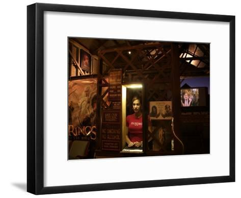 A Young Lady Mans the Window at the Sun Pictures Theater-Randy Olson-Framed Art Print
