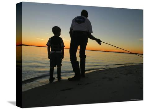 Father and Son Fishing at Dusk-Skip Brown-Stretched Canvas Print
