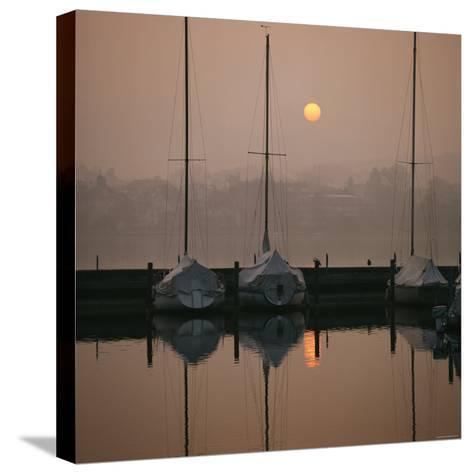Anchored Sailboats at Sunrise in Mythen Quai Harbor-David Pluth-Stretched Canvas Print