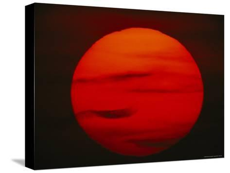 The Sun, Glowing Red as It Sets--Stretched Canvas Print