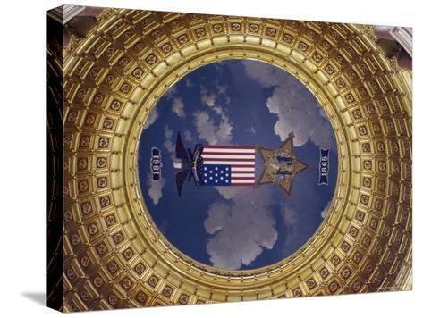 A Flag and State Emblem in the Dome of the Iowa State Capitol-Joel Sartore-Stretched Canvas Print