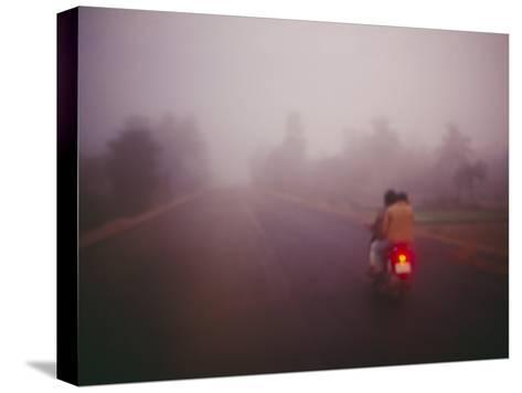 A Couple on a Motorcycle Head into Town Early in the Morning--Stretched Canvas Print