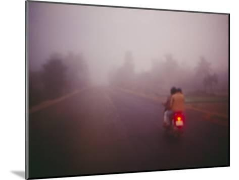 A Couple on a Motorcycle Head into Town Early in the Morning--Mounted Photographic Print