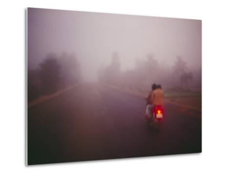 A Couple on a Motorcycle Head into Town Early in the Morning--Metal Print