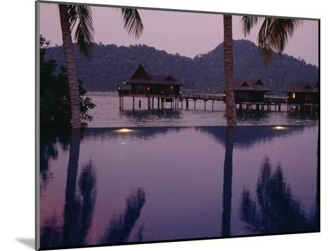 Reflections in a Pool and Traditional Malaysian Houses on Stilts--Mounted Photographic Print
