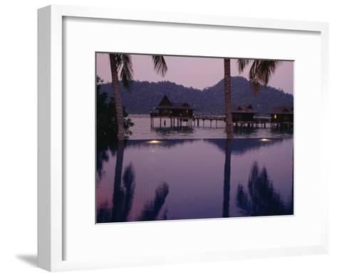 Reflections in a Pool and Traditional Malaysian Houses on Stilts--Framed Art Print