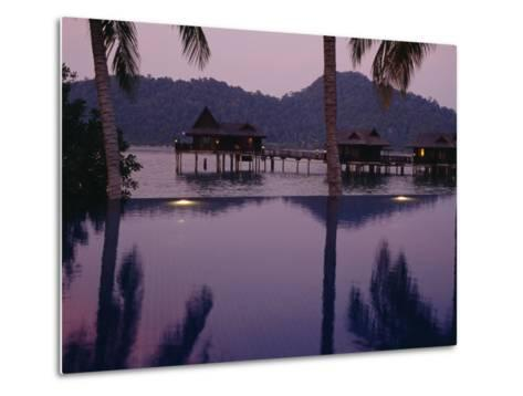 Reflections in a Pool and Traditional Malaysian Houses on Stilts--Metal Print