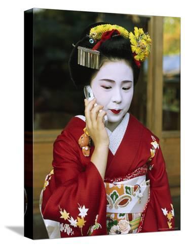 A Kimono-Clad Geisha Talks on a Cell Phone--Stretched Canvas Print