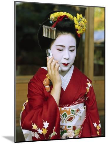 A Kimono-Clad Geisha Talks on a Cell Phone--Mounted Photographic Print