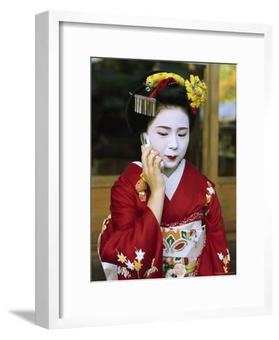 A Kimono-Clad Geisha Talks on a Cell Phone--Framed Art Print