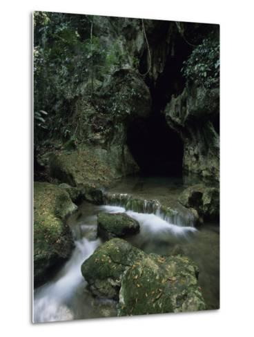 Water Flows from the Mouth of the Tunichil Muknal Cave--Metal Print