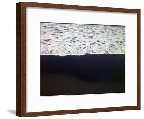 Frothy Pacific Ocean Water Pours onto a Black Sandy Beach-Raul Touzon-Framed Art Print