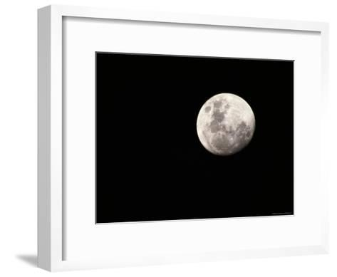 Large, Clear-Featured Moon on a Black Background, Chobe National Park, Botswana-Beverly Joubert-Framed Art Print