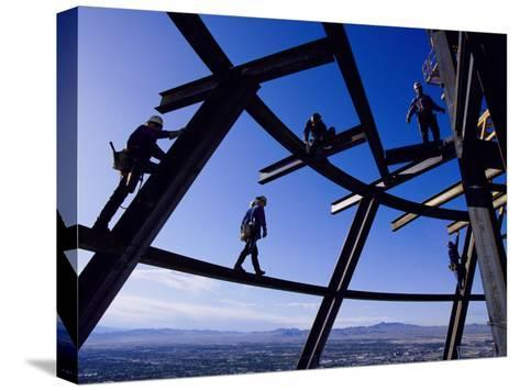 Construction Workers on Beams at the Top of the Statosphere Tower, Las Vegas, Nevada-Paul Chesley-Stretched Canvas Print