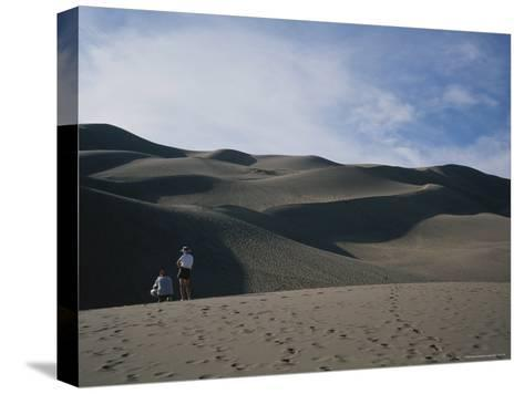 A Couple Look at the Dunes in Great Sand Dunes National Monument-Taylor S^ Kennedy-Stretched Canvas Print