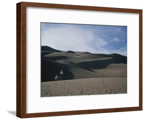 A Couple Look at the Dunes in Great Sand Dunes National Monument-Taylor S^ Kennedy-Framed Art Print