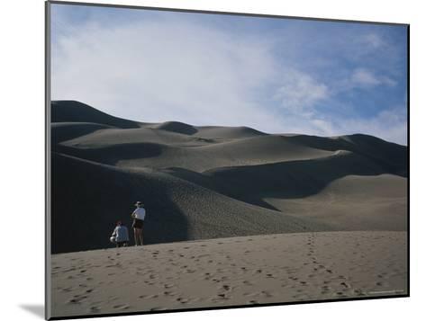 A Couple Look at the Dunes in Great Sand Dunes National Monument-Taylor S^ Kennedy-Mounted Photographic Print