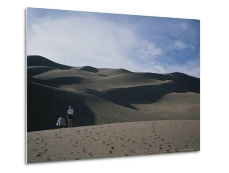 A Couple Look at the Dunes in Great Sand Dunes National Monument-Taylor S^ Kennedy-Metal Print