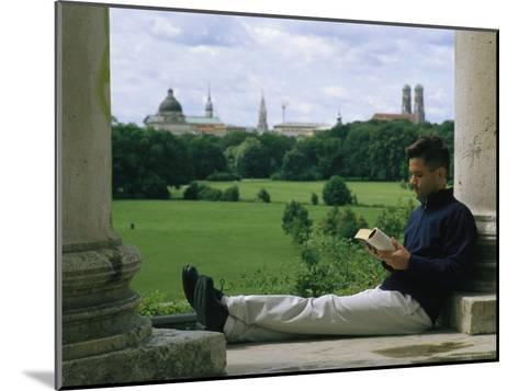A Man Reads in the English Garden in Munich-Taylor S^ Kennedy-Mounted Photographic Print