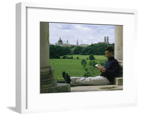 A Man Reads in the English Garden in Munich-Taylor S^ Kennedy-Framed Art Print