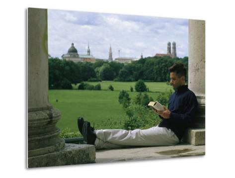 A Man Reads in the English Garden in Munich-Taylor S^ Kennedy-Metal Print
