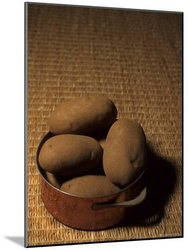 A Group of Baking Potatoes Sit in a Brass Cooking Pot-Taylor S^ Kennedy-Mounted Photographic Print