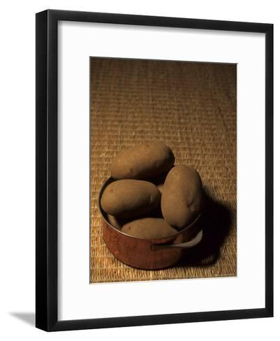 A Group of Baking Potatoes Sit in a Brass Cooking Pot-Taylor S^ Kennedy-Framed Art Print