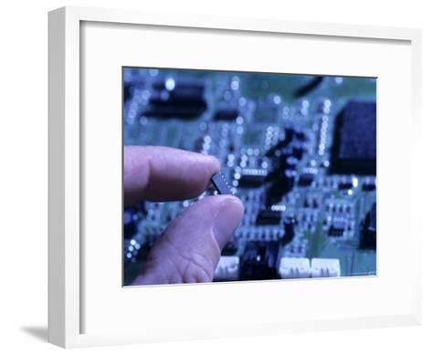 Fingers Hold up a Chip from a Computer Board-Taylor S^ Kennedy-Framed Art Print