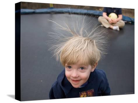 A Young Male Plays on a Trampoline Which Causes His Hair to Stick Up-Joel Sartore-Stretched Canvas Print