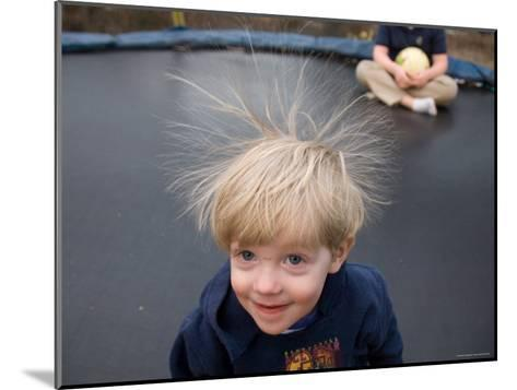A Young Male Plays on a Trampoline Which Causes His Hair to Stick Up-Joel Sartore-Mounted Photographic Print