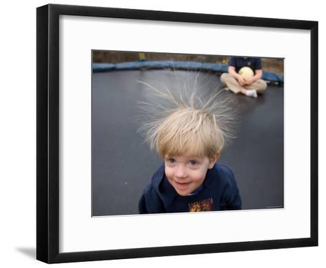 A Young Male Plays on a Trampoline Which Causes His Hair to Stick Up-Joel Sartore-Framed Art Print