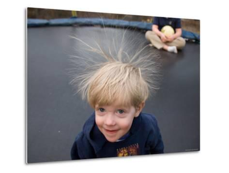A Young Male Plays on a Trampoline Which Causes His Hair to Stick Up-Joel Sartore-Metal Print