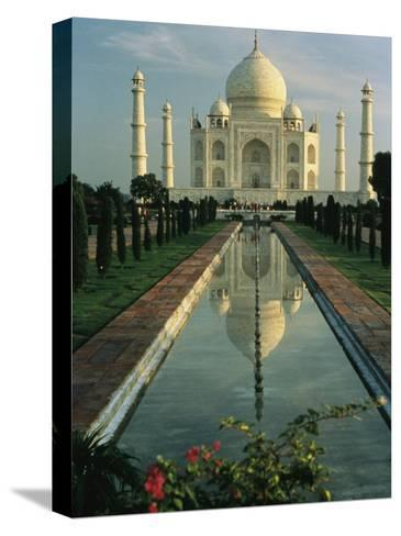 The Taj Mahal with a Reflection of the Tomb on the Surface of a Pool-Ed George-Stretched Canvas Print