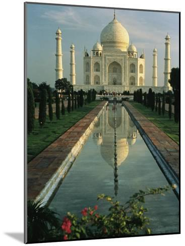 The Taj Mahal with a Reflection of the Tomb on the Surface of a Pool-Ed George-Mounted Photographic Print