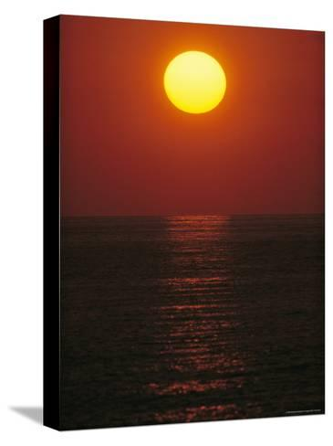A Golden Sunset on the Water-Raul Touzon-Stretched Canvas Print